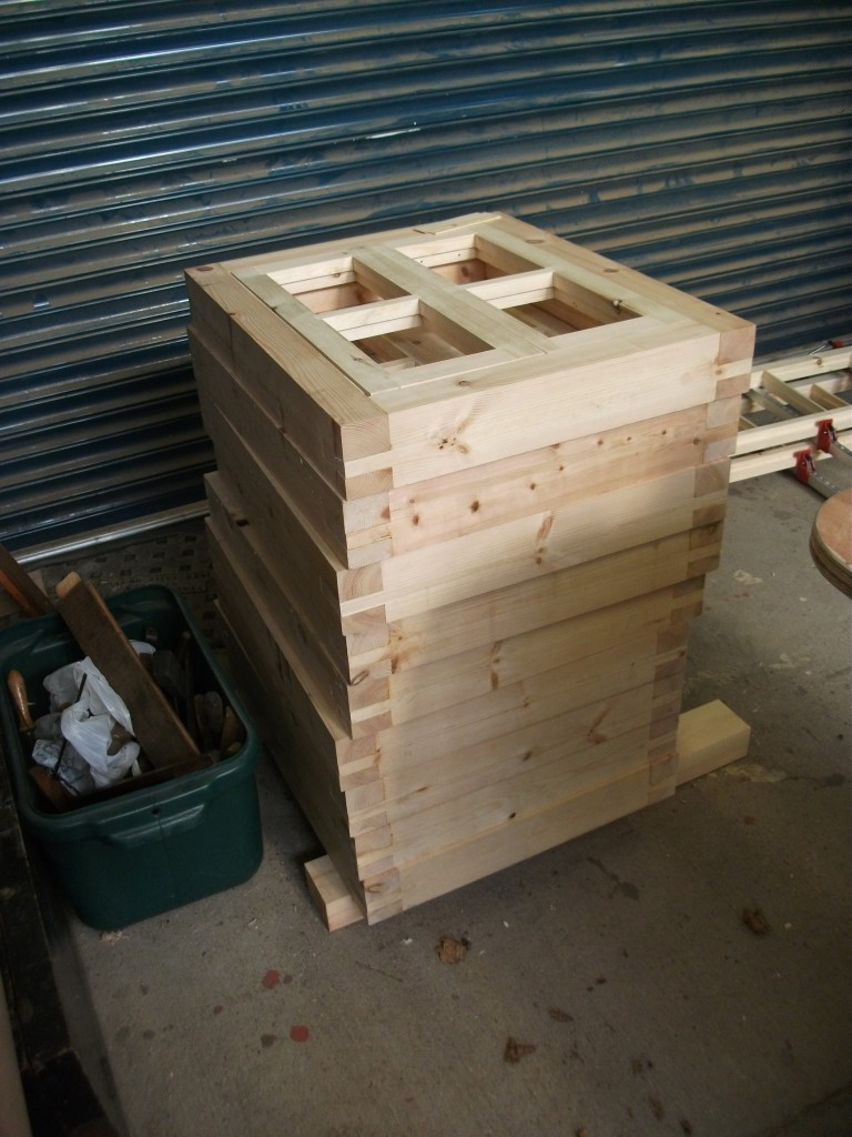 A stack of small windows ready for painting