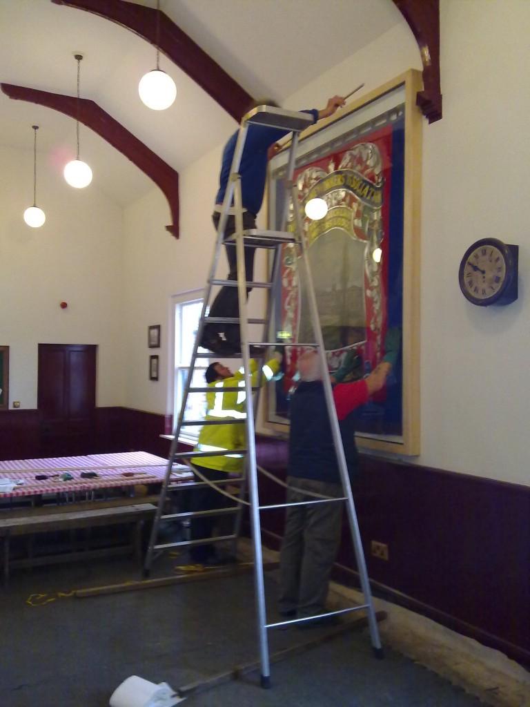 Rupert installing the glass