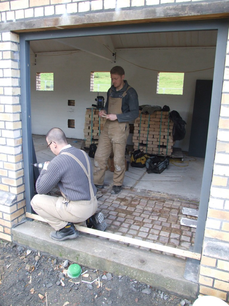 Shaun and Daniel fixing one of the double door frames.