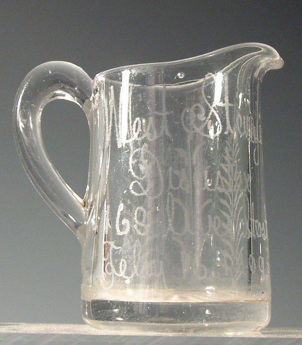 Disaster glass milk jug, inscribed West Stanley Disaster 168 lives, Feb 16 1909.