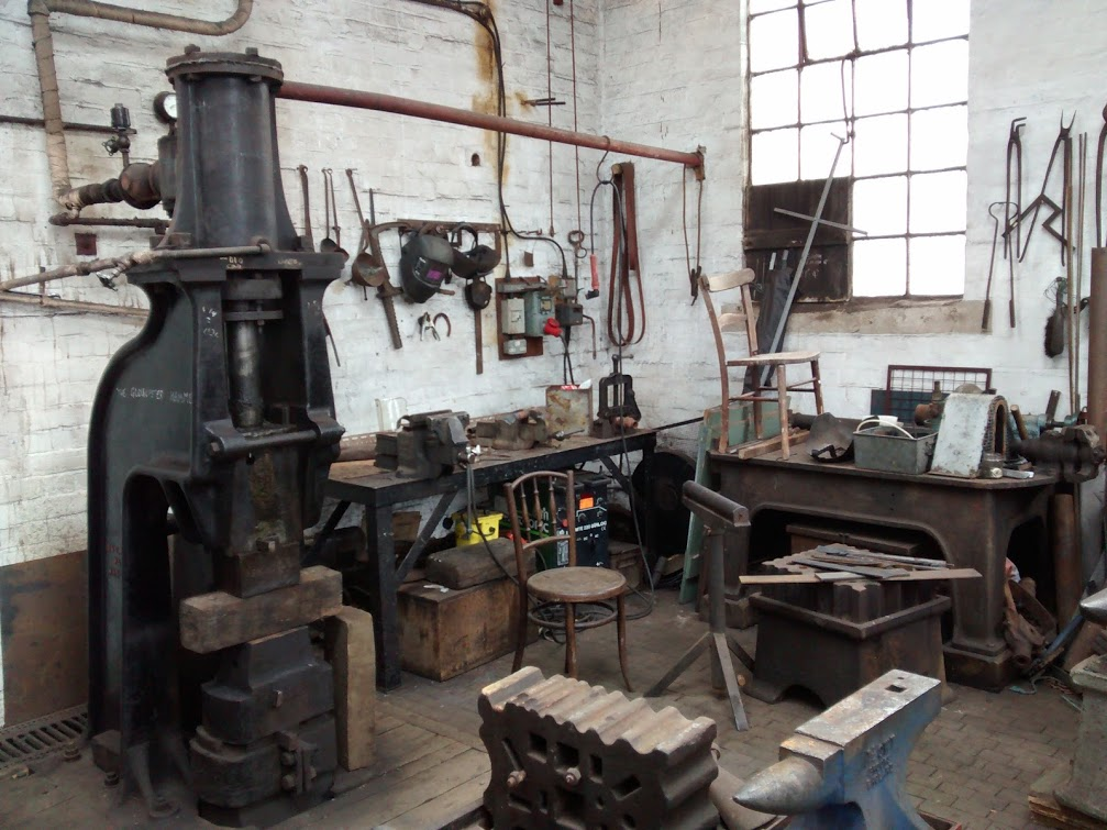 Opposite the forge, a very useful steam hammer